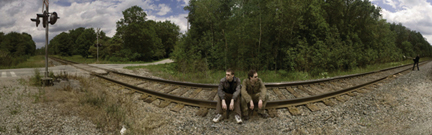 photo of people sitting on train track