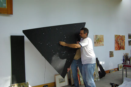 people carrying panel to place in art installation