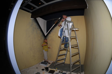 fish eye lens view of room under construction with ladder