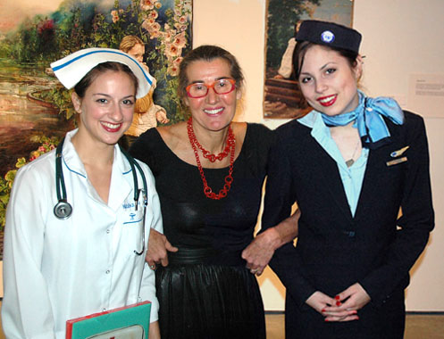 costumed people and artist in gallery