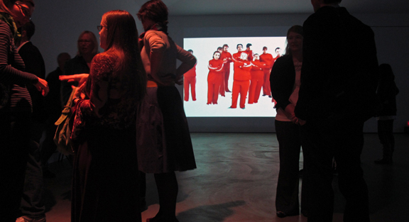 people looking at video art