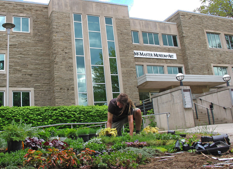 Simon Frank planting his Artist's Garden, Untilled, at McMaster