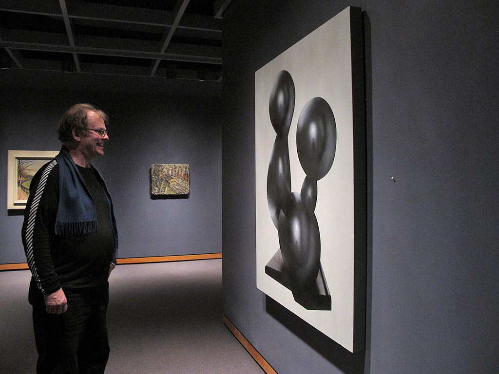 Artist Chris Cran with his painting