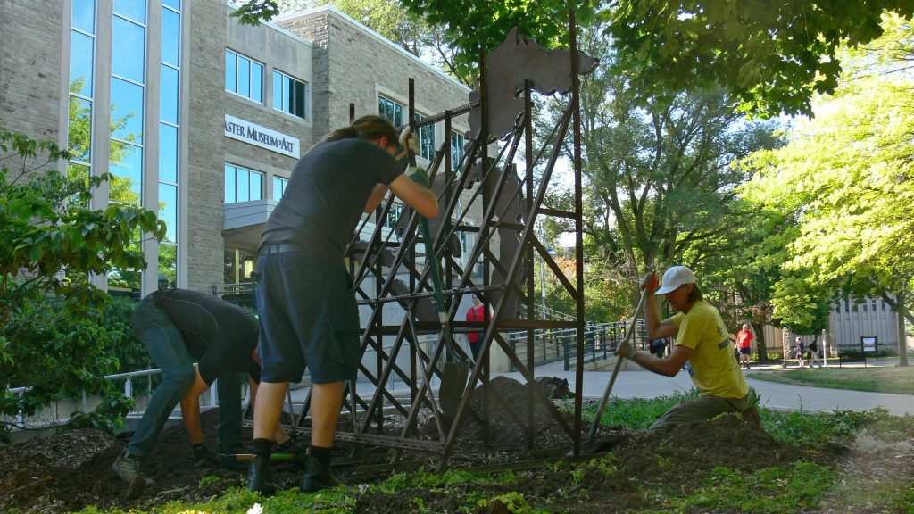 TH&B installing 'Basin' in the McMaster Museum of Art's Artist Garden