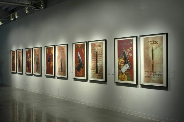 Installation view of Simon Glass, The Ten Commandments / Prohibited Weapons suite of ten giclée prints embellished with 23.5k gold leaf, 2005. Courtesy of the artist
