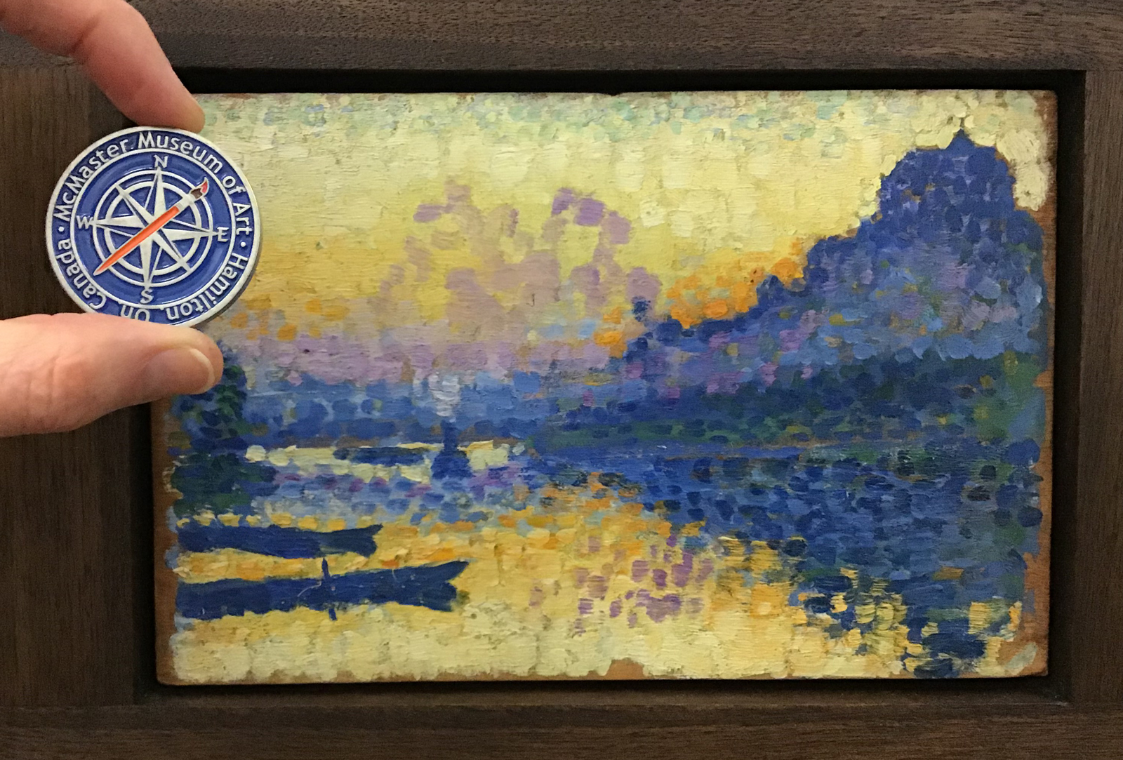 Lemmen Geocoin with painting from McMaster's collection, for which it was named.