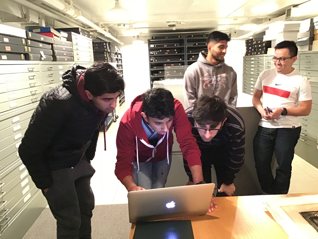 Engineering Students callibrating their device in the Paper Centre of McMaster Museum of Art
