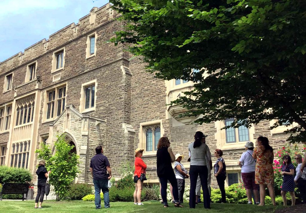 Tour group looking at Hamilton Hall, McMaster University