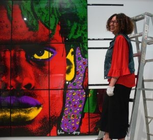 Pamela Edmonds, Senior Curator, during installation of the exhibition