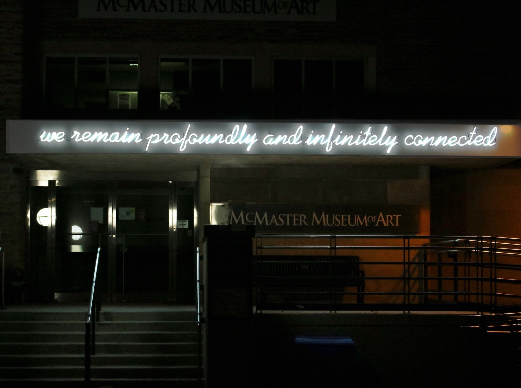 Hiba Abdallah neon art installation on front of Museum building, view from October 2020.