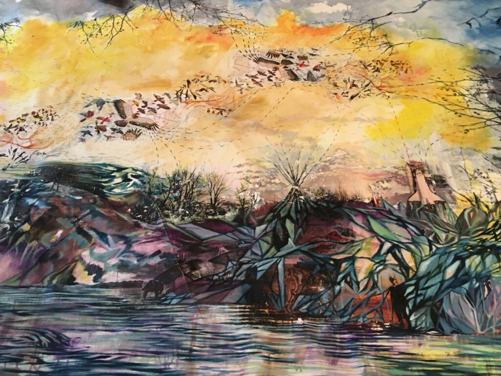Multi coloured painting of a body of water with marshland, and a yellow sky above with birds